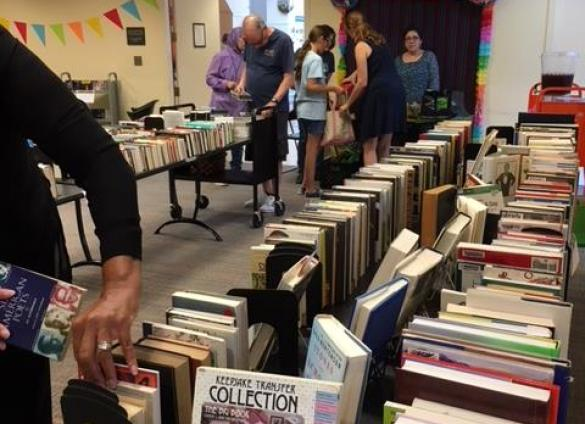 Library customers browse the 2018 Big Book Sale at Independence Regional