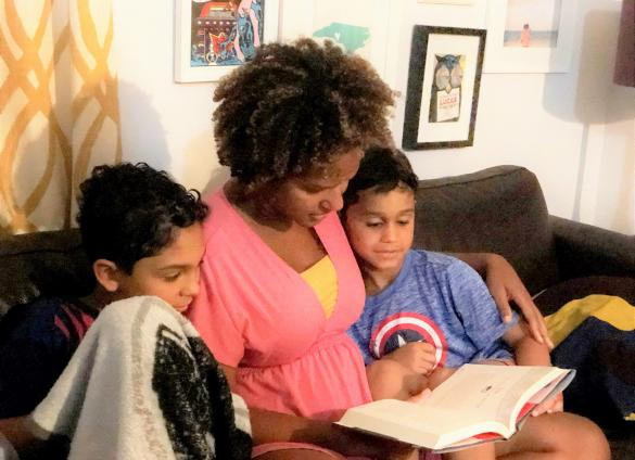 Ailen Arreaza reads to her two sons as Charlotte Mecklenburg Library cardholders and aficionados.
