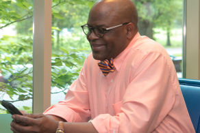Man reading on his mobile device at Charlotte Mecklenburg Library.