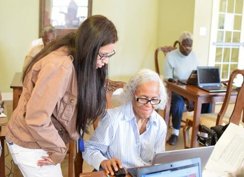 Library staff help seniors with digital literacy