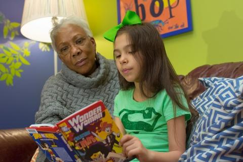 A Library volunteer reading with her buddy
