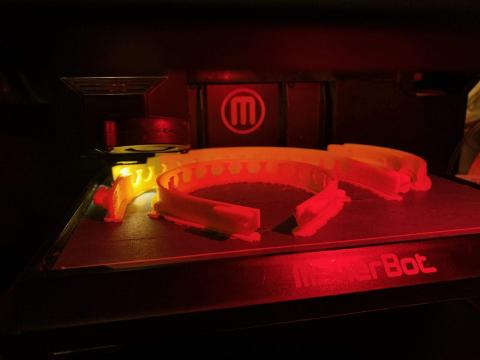 Charlotte Mecklenburg Library makerspace 3D printers assist in medical mask production.